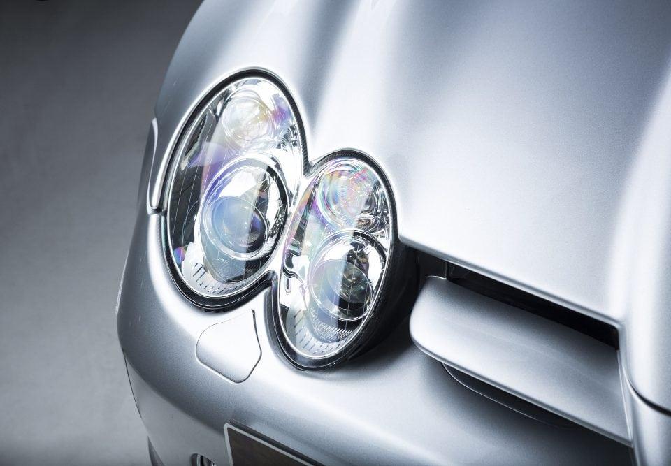 closeup shot headlight silver car
