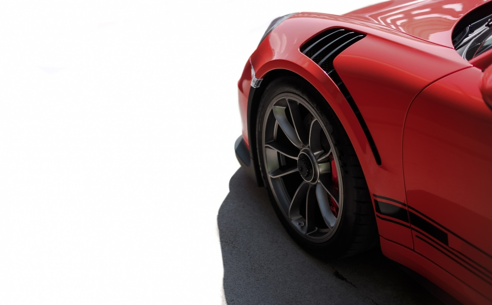 red sport car front side view black wheel with metallic silver color